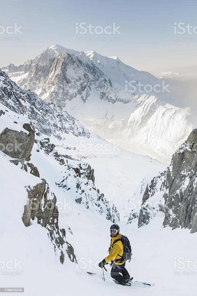 Skier in couloir with Mont Blanc as background stock photo