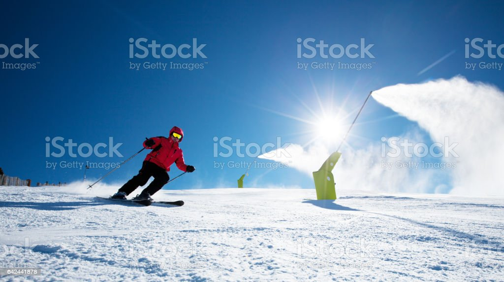 Skier in mountains stock photo