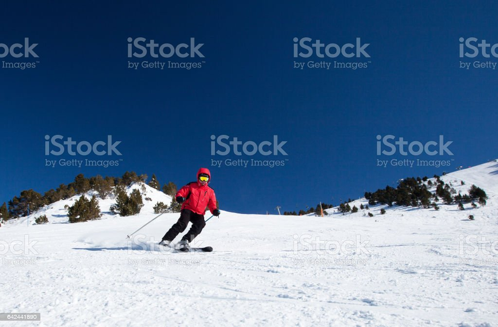 Skier in mountains stock photo