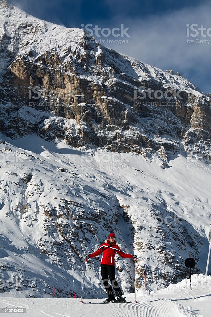 skier in red equipment in the Alps stock photo