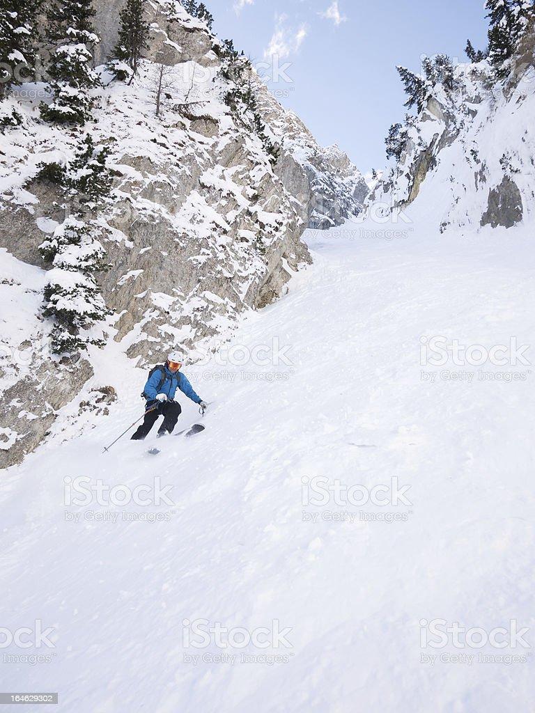 Skier in steep chute royalty-free stock photo