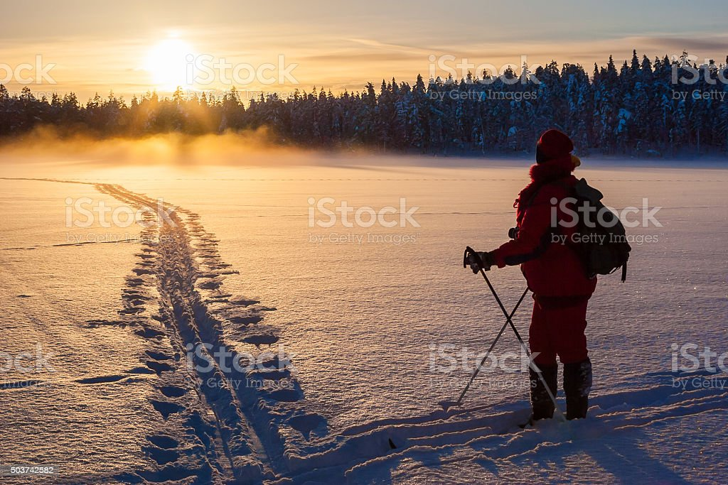 Skier in sunset stock photo