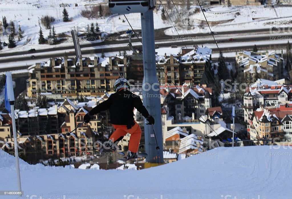 Skier in Terrain Park Jump at Lionshead Vail stock photo