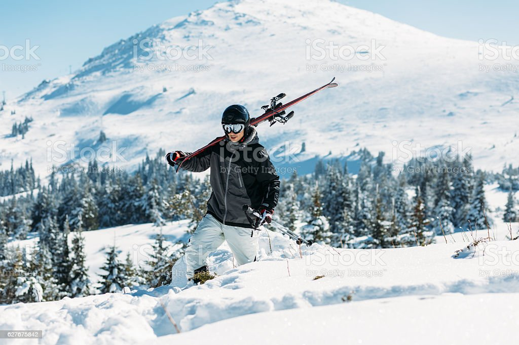 Skier in the snowy mountain stock photo