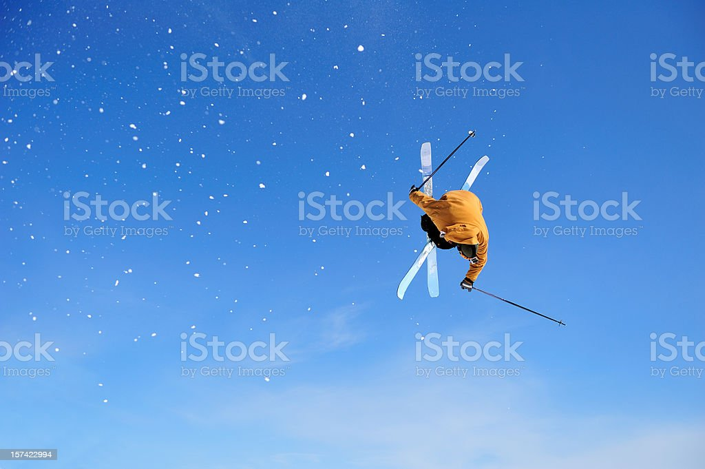 Skier Iron Cross stunt against blue sky stock photo