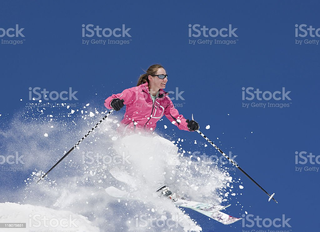 Skier Jumping Against Blue Sky royalty-free stock photo