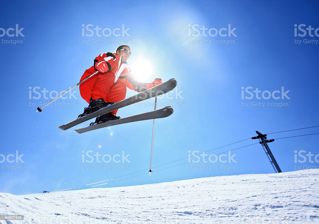 Skier jumping against the sun. royalty-free stock photo