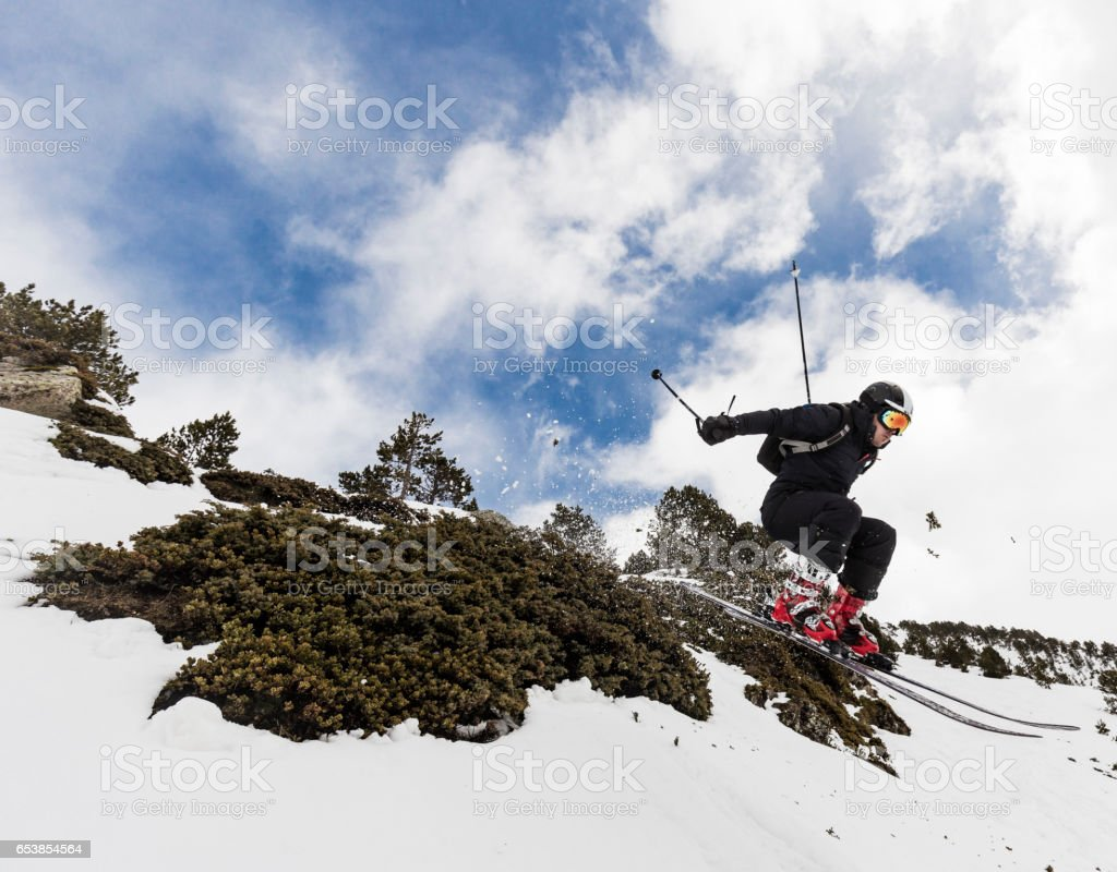 Skier jumping backcountry stock photo