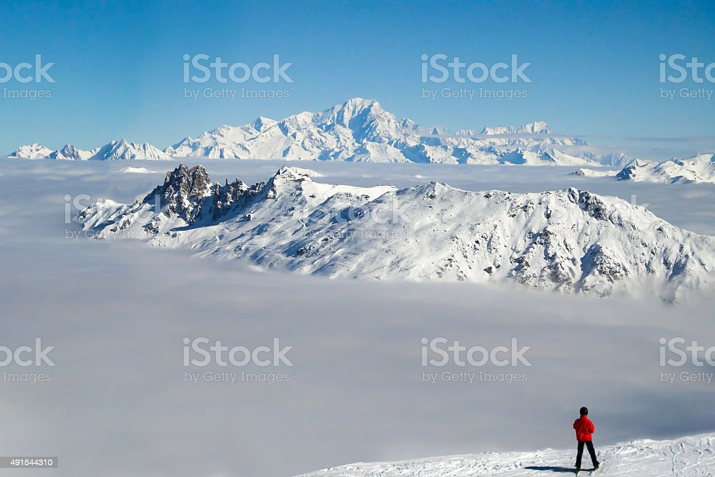 Skier looking at the Mont Blanc, the Alps, France stock photo