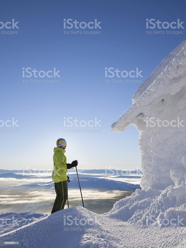 Skier looking down on cloud covered valley royalty-free stock photo