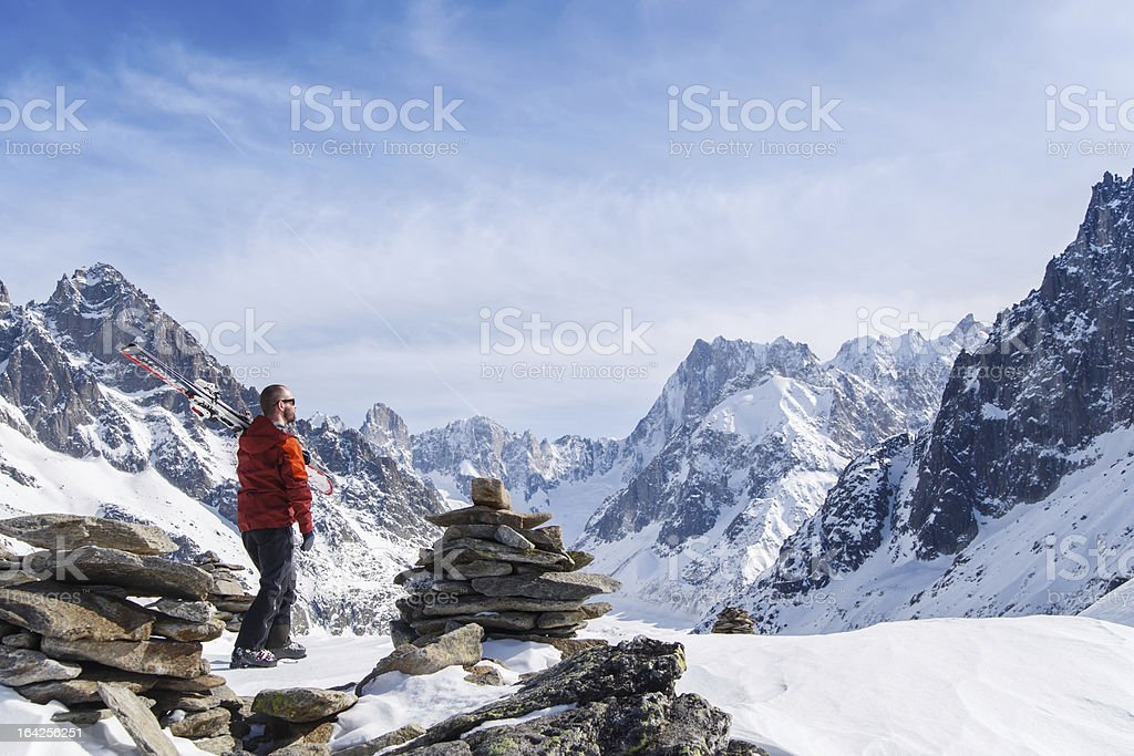 Skier looking out over mountain landscape royalty-free stock photo
