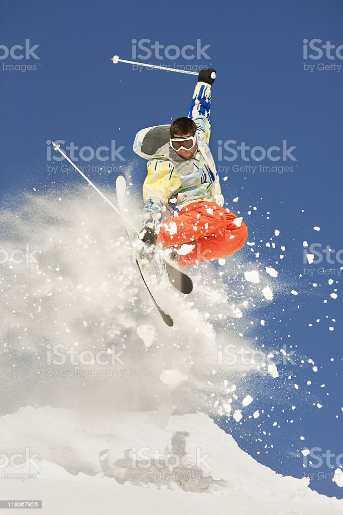 Skier Making Incredible Jump In Powder Snow royalty-free stock photo
