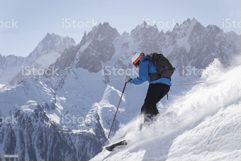 Skier making turn in powder snow royalty-free stock photo