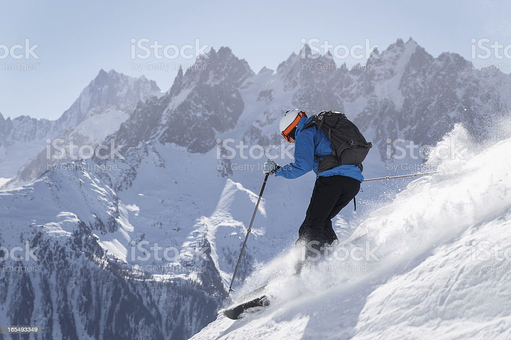 Skier making turn in powder snow stock photo