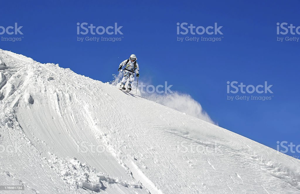 Skier on a background of clear sky royalty-free stock photo