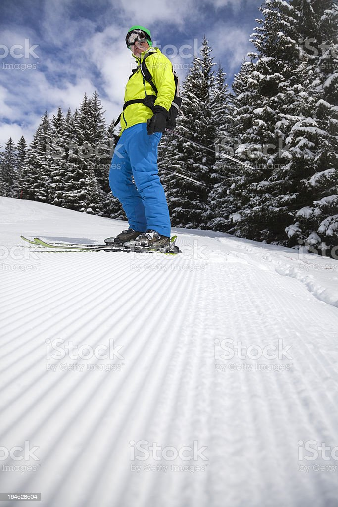 Skier on freshly groomed slope royalty-free stock photo
