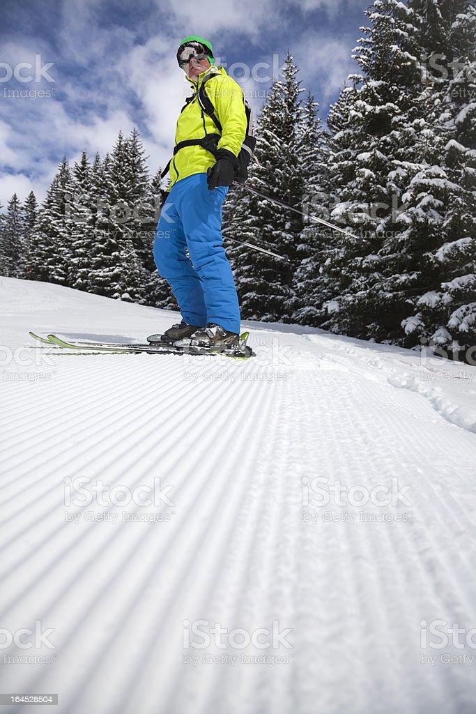 Skier on freshly groomed slope stock photo