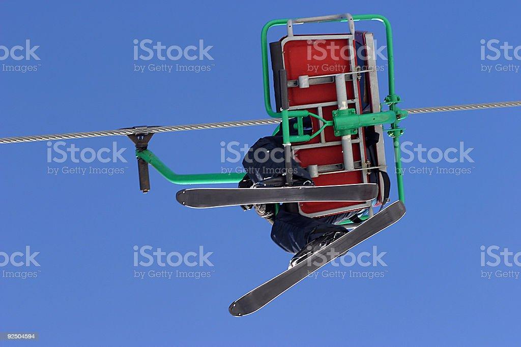 Skier on ski lift royalty-free stock photo