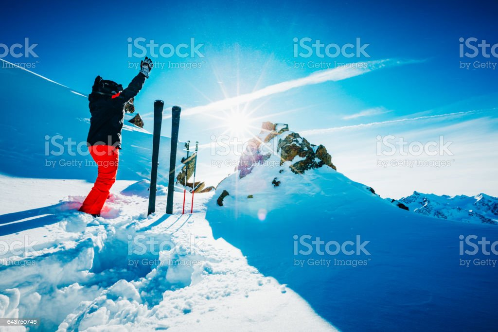 Skier on slope with hands in the air stock photo