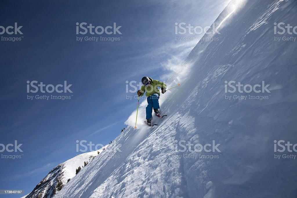 Skier on steep slope royalty-free stock photo