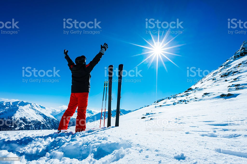 Skier on top of ski resort stock photo