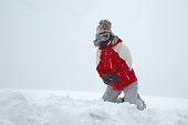 Skier playing with snow