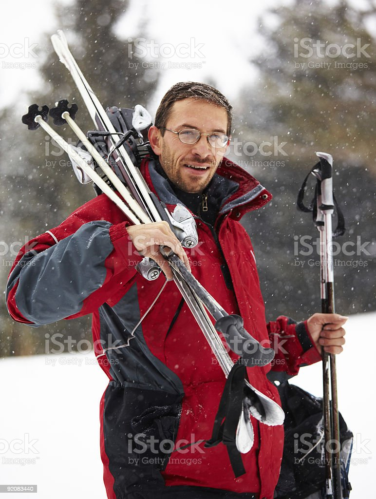 Skier portrait and snowfall royalty-free stock photo