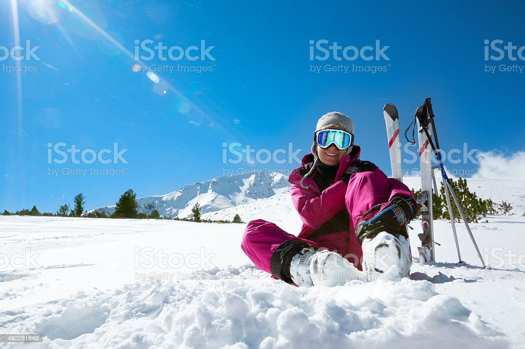 Skier resting on the ski slope stock photo