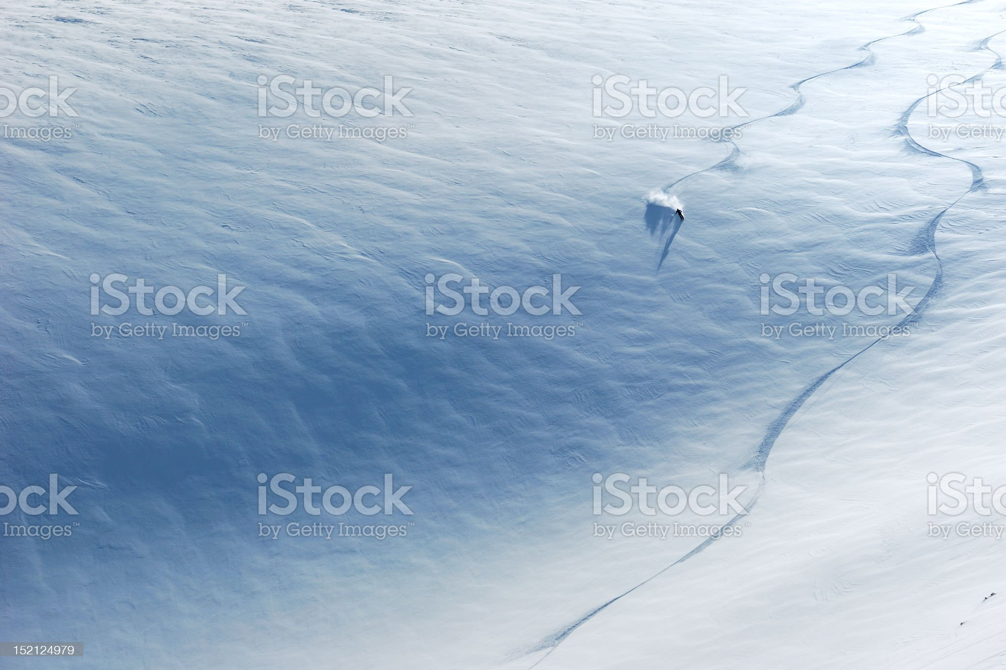 Skier riding down the slope royalty-free stock photo