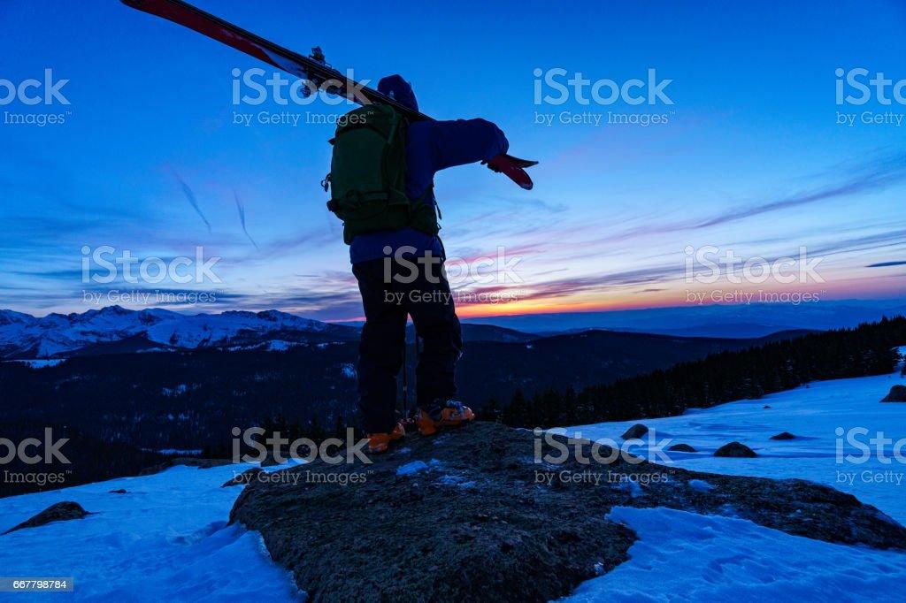 Skier Silhouette in Mountains stock photo