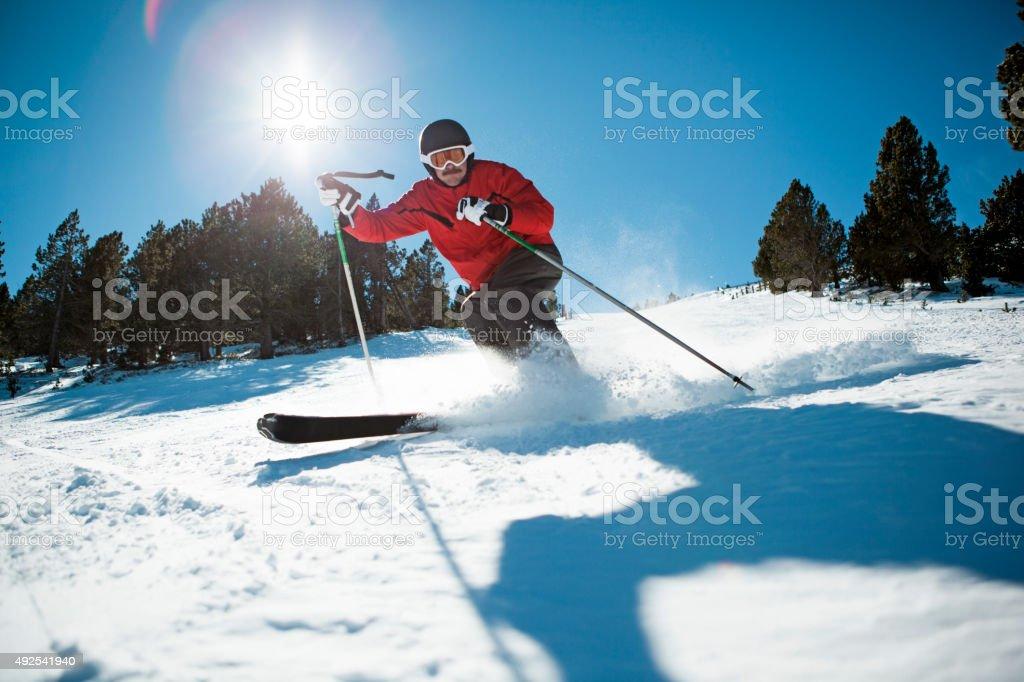 Skier skiing down a mountain stock photo