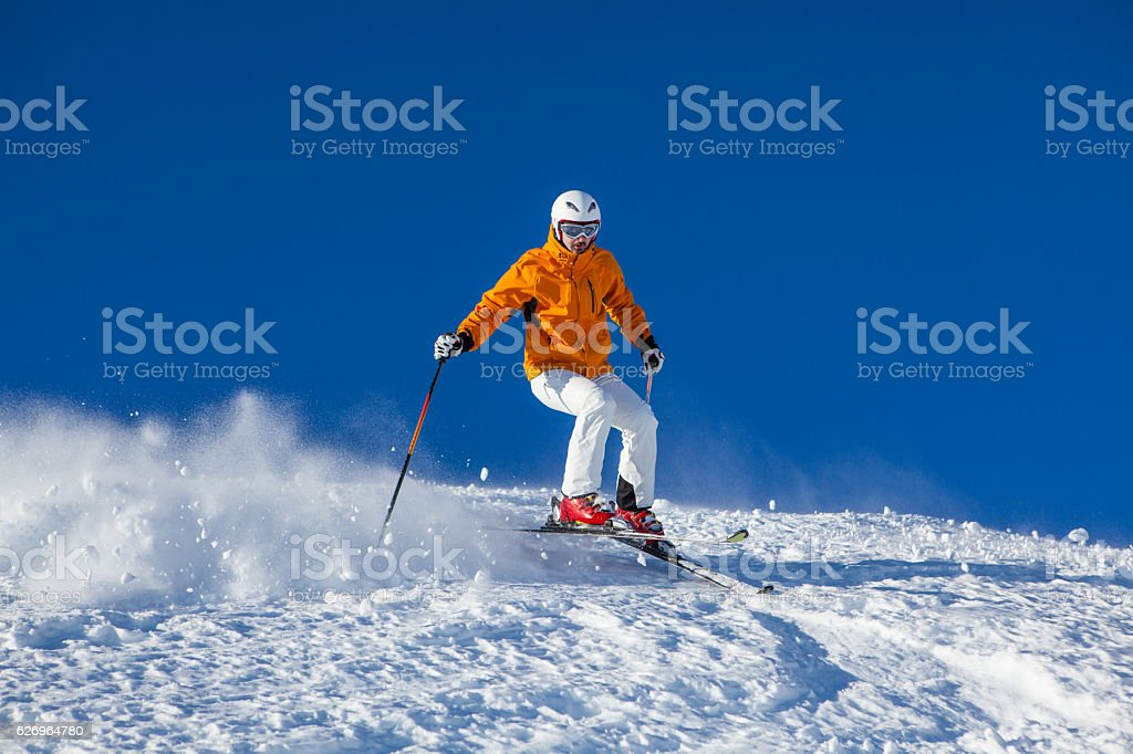 skier skiing in rough snow stock photo