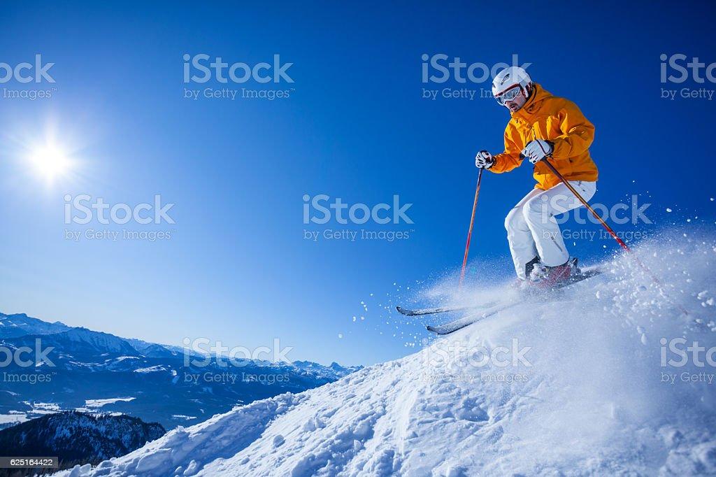 skier skiing off the beaten track stock photo