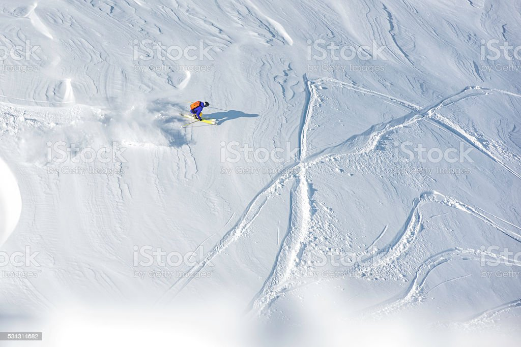 Top view of a free skier on a snowcapped hill, copy space.