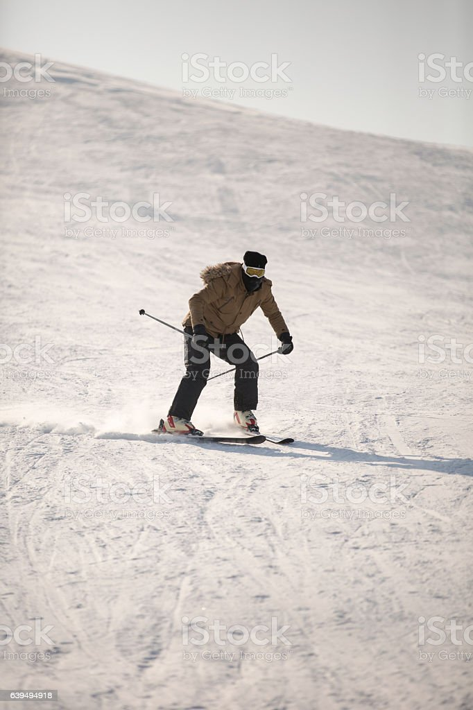 Skier skiing off-piste on a beatiful mountain slope stock photo