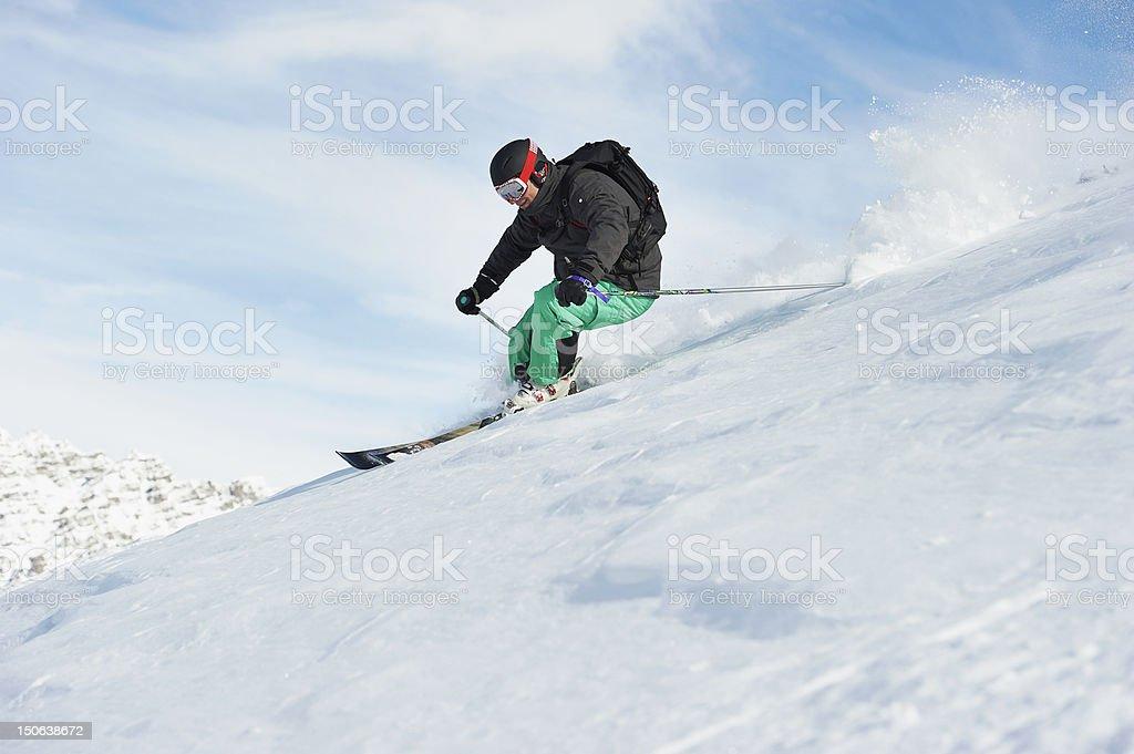 Skier skiing on snowy slope stock photo