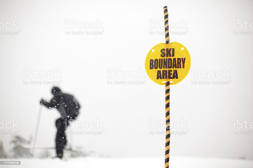 Skier Skiing Out of Bounds and Dropping off Cliff stock photo