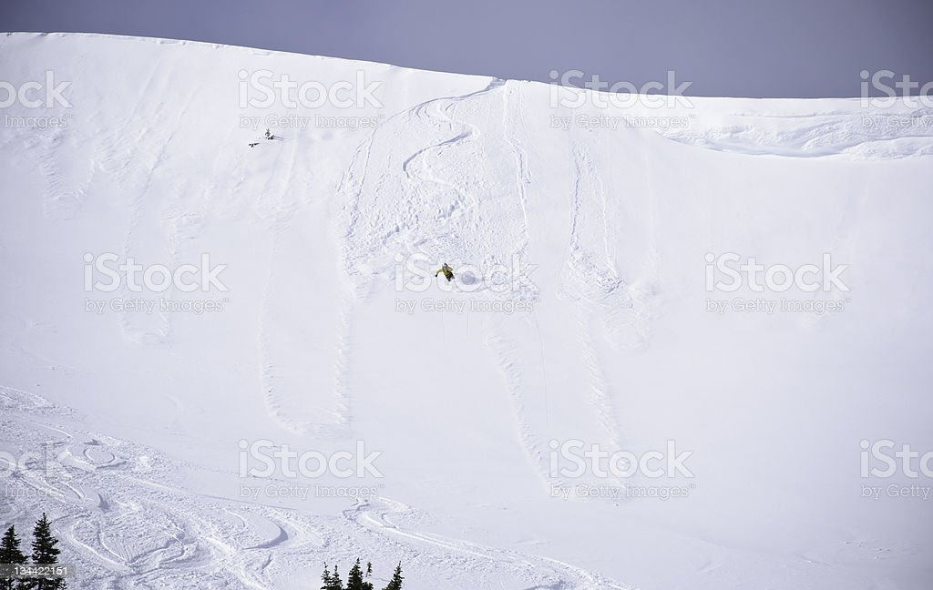 Skier Skiing Steep Slope Cornice Sekirk Mountains Canada royalty-free stock photo
