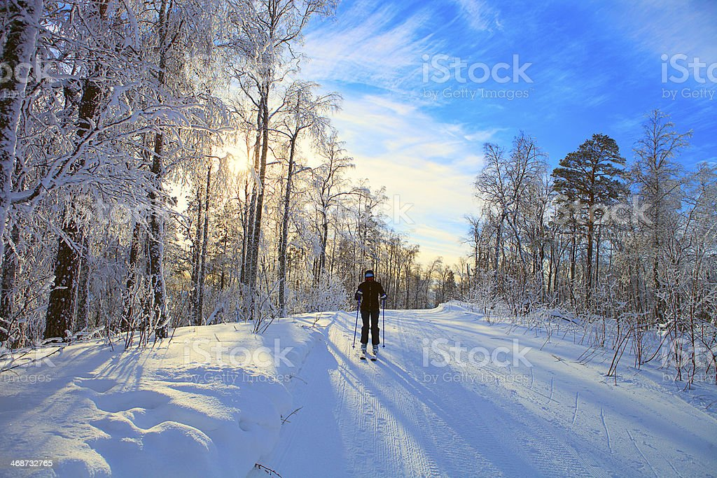 Skier slides down the mountain stock photo
