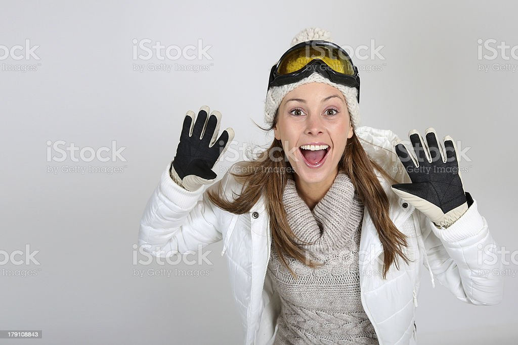 Skier smiling with hands up on holidays royalty-free stock photo
