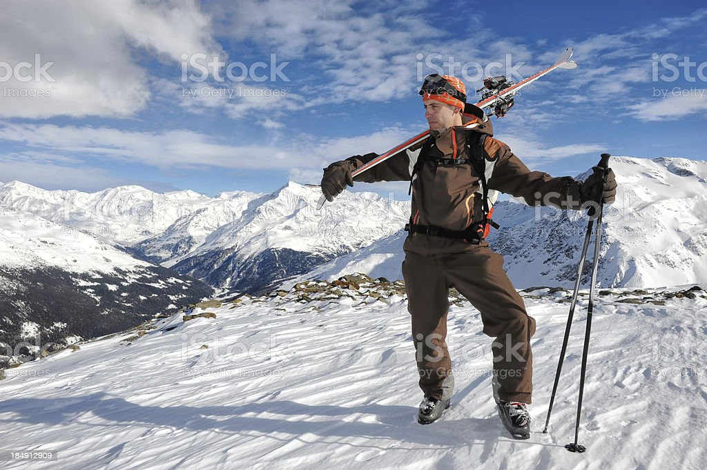 Skier standing on the snowy top royalty-free stock photo