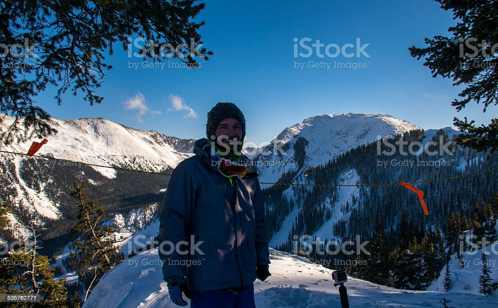Skier Stands on the Edge Taos Ski Valley Overlook stock photo