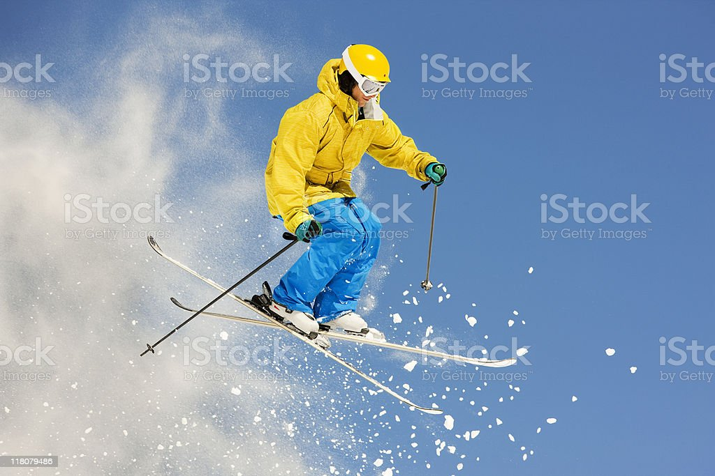 Skier Suspended In Mid-Air Against Blue Sky royalty-free stock photo
