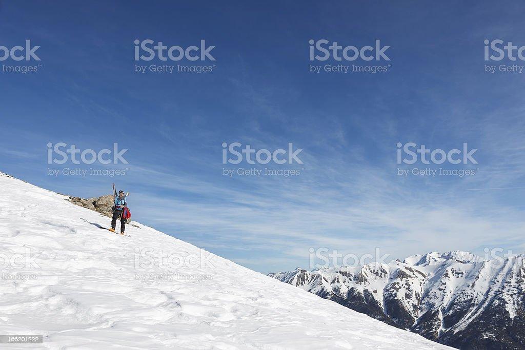 Skier taking photograph of mountains. royalty-free stock photo