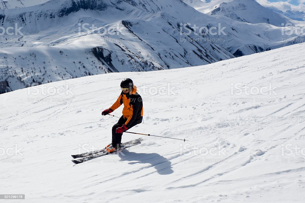 skier turning down the mountain stock photo