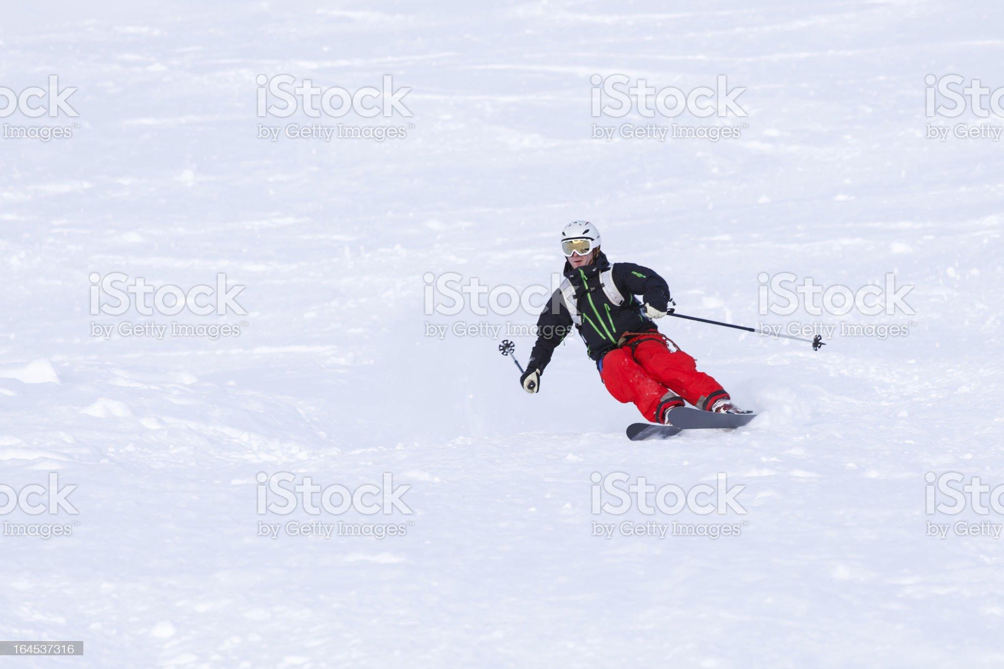 Skier turning in powder snow royalty-free stock photo