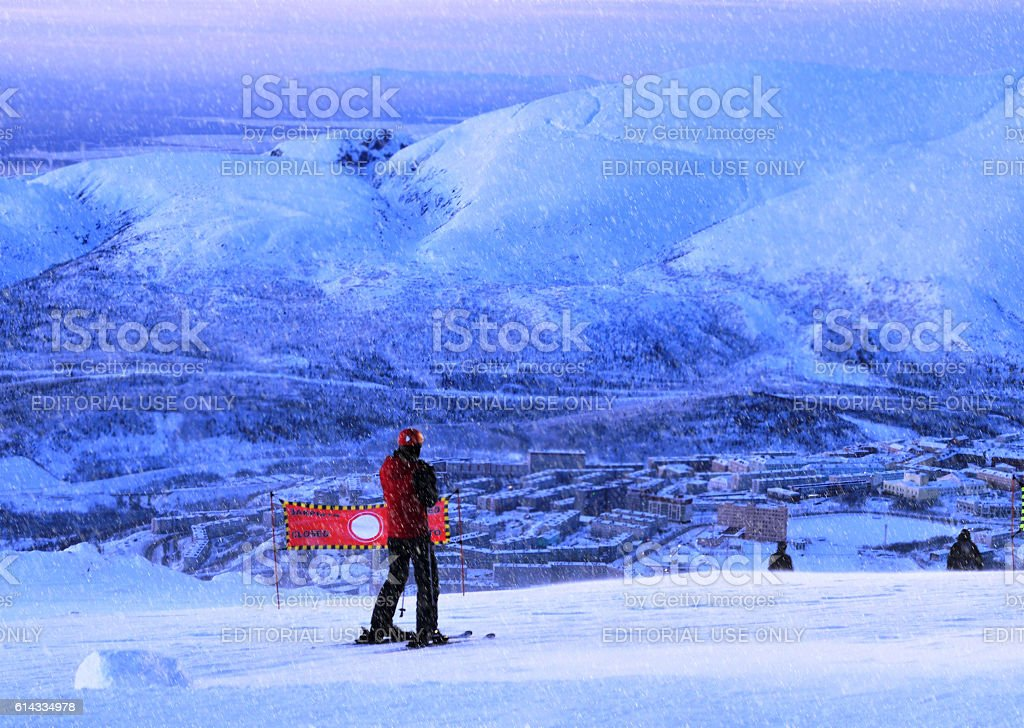 Skier wants to move out from mountain stock photo