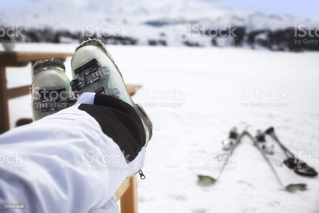 Skier with feet up and skis in background stock photo