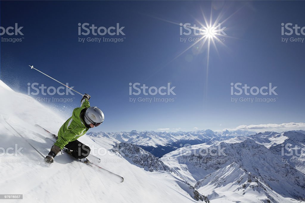 Skier with sun and mountains stock photo