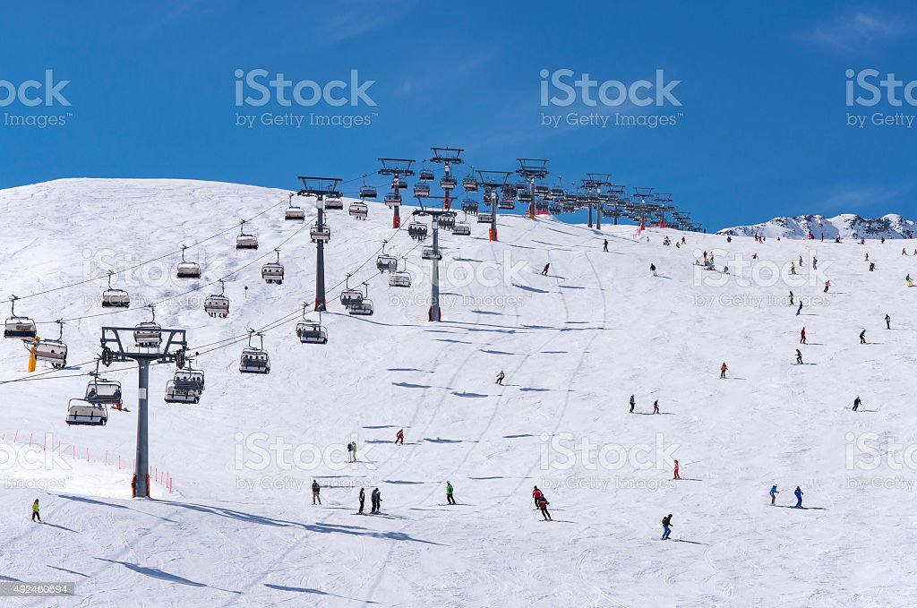 Skiers and chairlifts in Solden, Austria stock photo